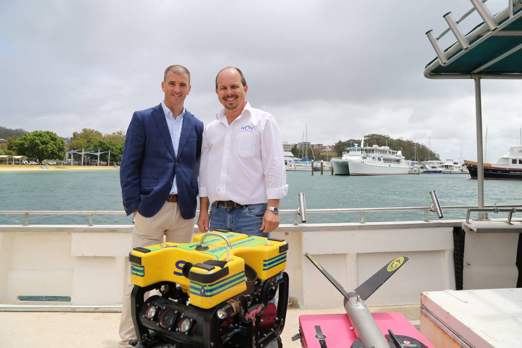 Ed Korber, managing director of Subsea, and Michael Porritt, director of ROV Innovations, with one of the remotely operated underwater vehicles that will be used to locate submerged shipping containers from the YM Efficiency. Picture: Ellie-Marie Watts